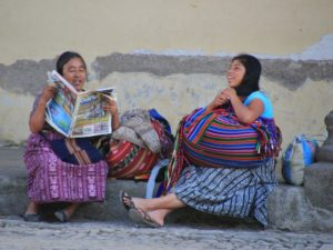Woman reading local paper