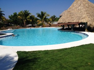 New swimming pool with bar at Cafe del Sol